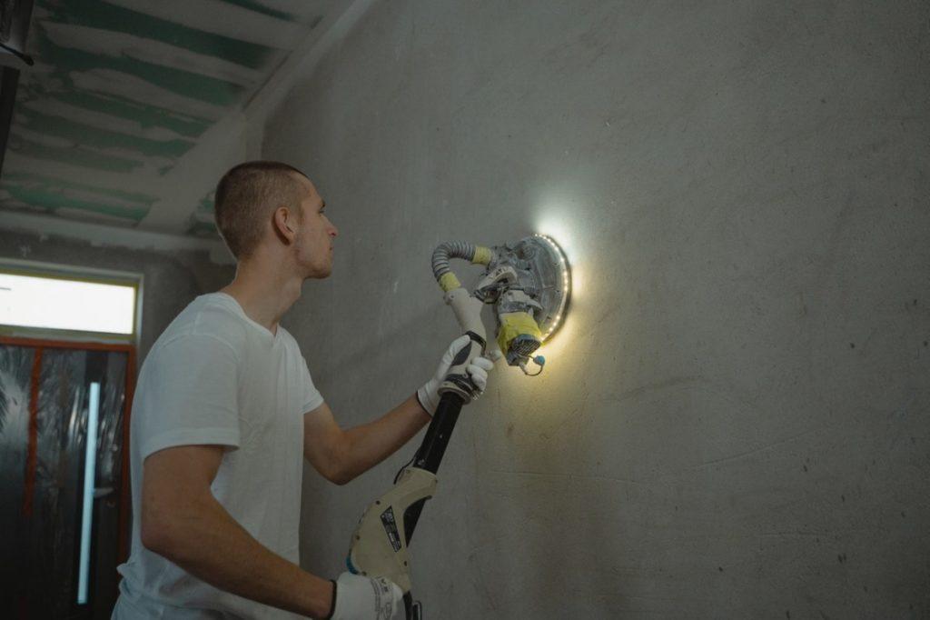 man polishing a wall